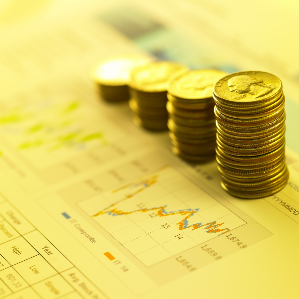 finance/a graph and coin towers